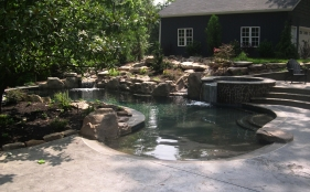 Gunite Pool with Spa, Scupper, Beach Entry, Tanning Ledge, and Rock Waterfall
