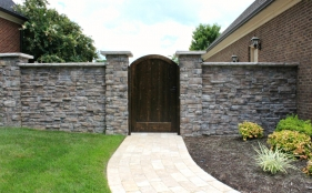 Stone Fence and Wooden Door Entry