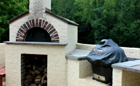 Outdoor Kitchen with Stone Over & Primo Grill