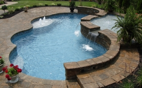 Freeform Fiberglass Pool with Raised Spa Sheer Descents and Bubblers